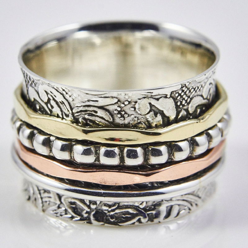 Four Band Spinner Ring